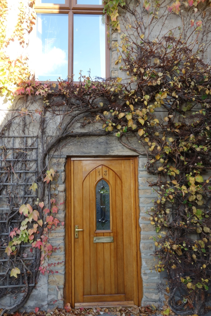 Some beautiful fall colors embellish this rather small door.
